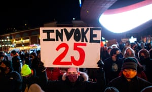 A protester in Brooklyn holds a sign calling for the 25th amendment to remove Donald Trump