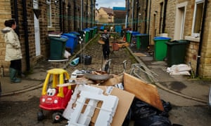 Residents in Littleborough, where 180 households have been flooded out, clear up their homes