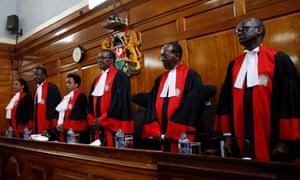 Kenya's supreme court judges arrive at the courtroom before delivering their ruling.