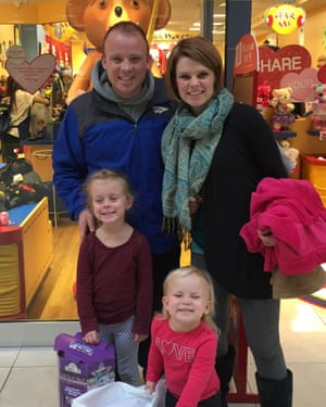 Lee Waldron, pictured with his wife, Sara Jo, and daughters Penelope (left) and Lydia, has cut his student debt dramatically through a buyback scheme in rural Kansas.