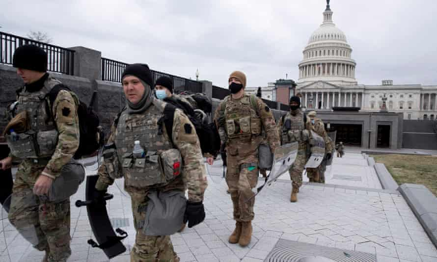 Members of the national guard walk at the East Front of the US Capitol in Washington.