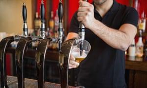 Barman pulling a pint of beer