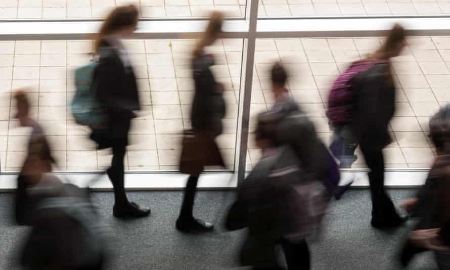 Secondary school pupils walking in a corridor