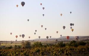Hot-air balloons fly over the historical Cappadocia region of Turkey