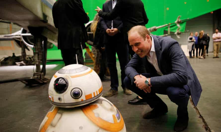 Prince William smiles at the BB-8 droid.