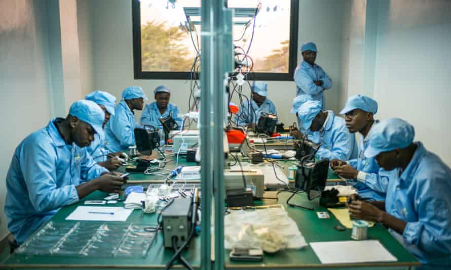 Employees construct mobile phones in a factory in Brazzaville.