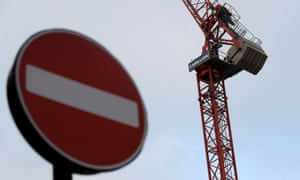 Cranes at a Carillion construction site in central London with a no entry sign in the foreground
