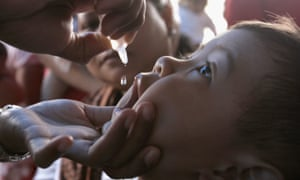 A health worker vaccinates a child against polio in Jakarta, Indonesia.