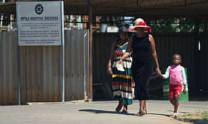 Two women and a child arrive at Mpilo central hospital in the city of Bulawayo