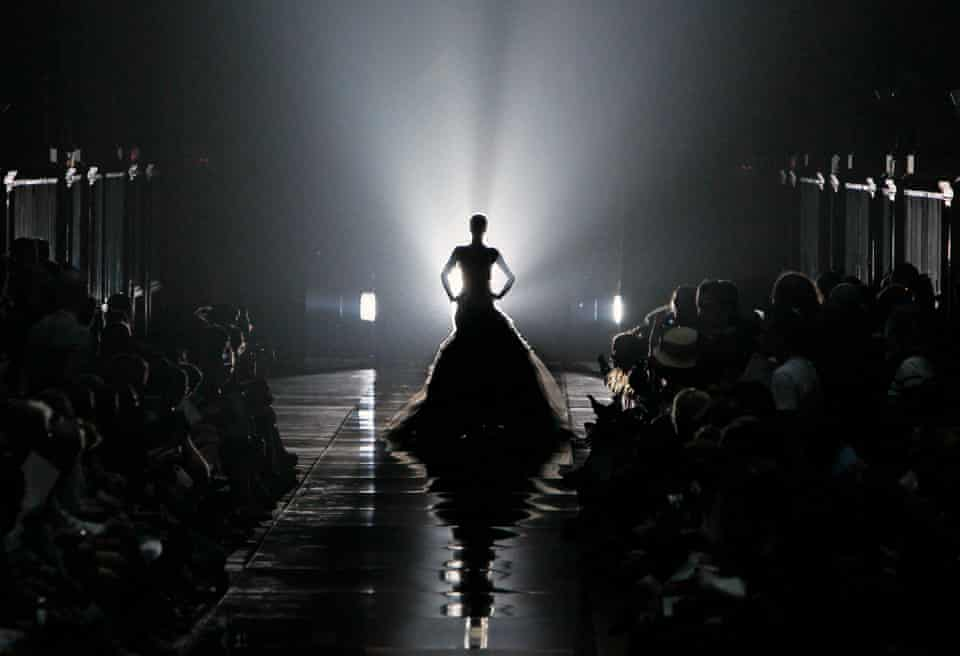A model wears a creation by British fashion designer Bill Gaytten for John Galliano's fashion house spring-summer 2012 ready-to-wear collection