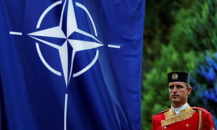 A Montenegrin guard of honor stands next to a Nato flag during a ceremony to mark the accession to Nato of Montenegro in Podgorica, Montenegro, on 7 June 2017.