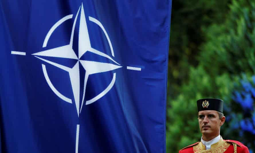 A Montenegrin guard of honour stands next to Nato flag during a ceremony to mark Montenegro's accession to the organisation in June 2017.