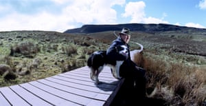 John Sheridan, a farmer and landowner, stands beside the Cuilcagh mountain boardwalk, peering out at the border in Florencecourt, Northern Ireland