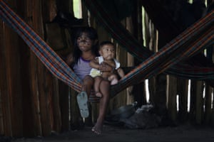 Members of the Ka'apor community are seen in a village established by the indigenous leaders
