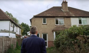 Keir Starmer standing outside the home in Oxted, Surrey, where he grew up.