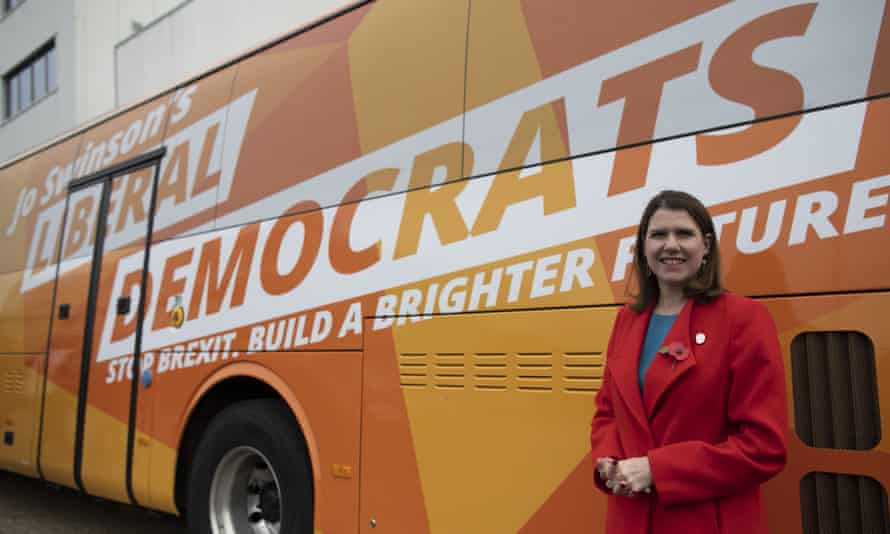o Swinson stands in front of the party's campaign bus