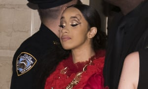 Cardi B, with a bump on her forehead, leaving the Harper's Bazaar party