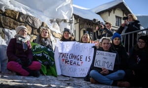 Greta Thunberg (left) takes part in a 'school strike for climate' at the World Economic Forum in Davos, Switzerland.