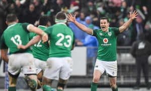 Jonathan Sexton of Ireland celebrates with team-mates after kicking the match-winning drop goal against France
