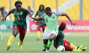 Desire Oparanozie of Nigeria powers through the challenges of Cameroon's Raissa Feudjio (left) and Christine Manie during their Women's African Cup of Nations semi-final.