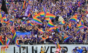 Orlando City fans wave rainbow flags after last week's shooting at a gay nightclub