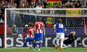 Atlético Madrid's Antoine Griezmann scores their first goal from the penalty spot.