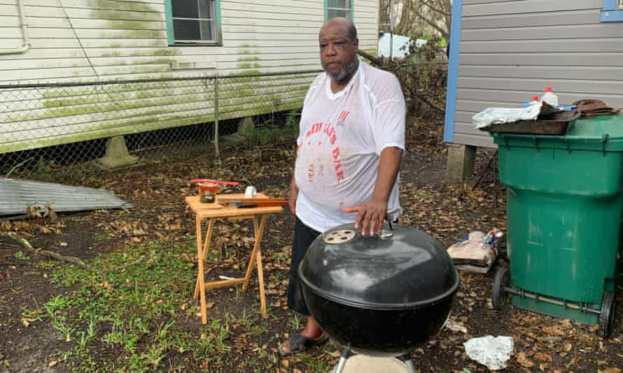 Brian Millet beside his barbecue at his Ida-damaged home in Reserve, Louisiana