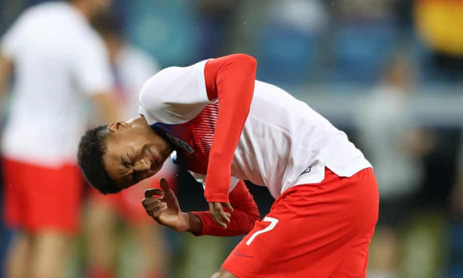 England's Jesse Lingard reacts after an insect lands on him before the game.