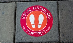 A Covid-19 social distancing sticker outside a shop in Windsor, Berkshire.