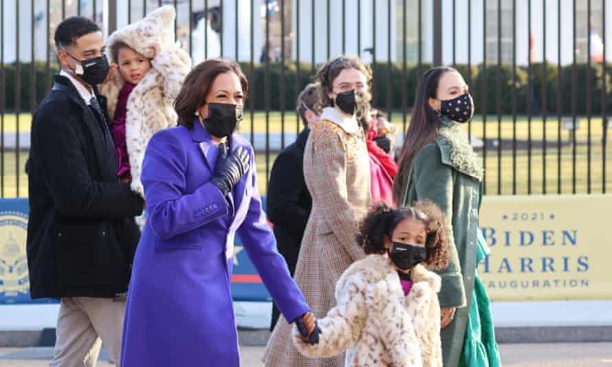 Kamala Harris walks with family down Pennsylvania Avenue in Washington DC on 20 January.