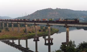 A diesel locomotive carrying loaded lorries on Shashtri bridge near Sangmeshwar, in Maharastra.