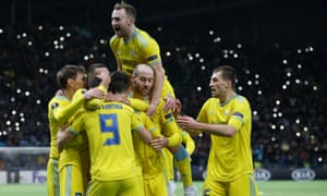 Astana players celebrate after Manchester United's Di'Shon Bernard scores an own goal to give Astana a 2-1 lead.
