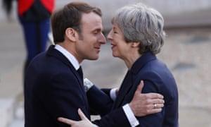 Theresa May greets Emmanuel Macron