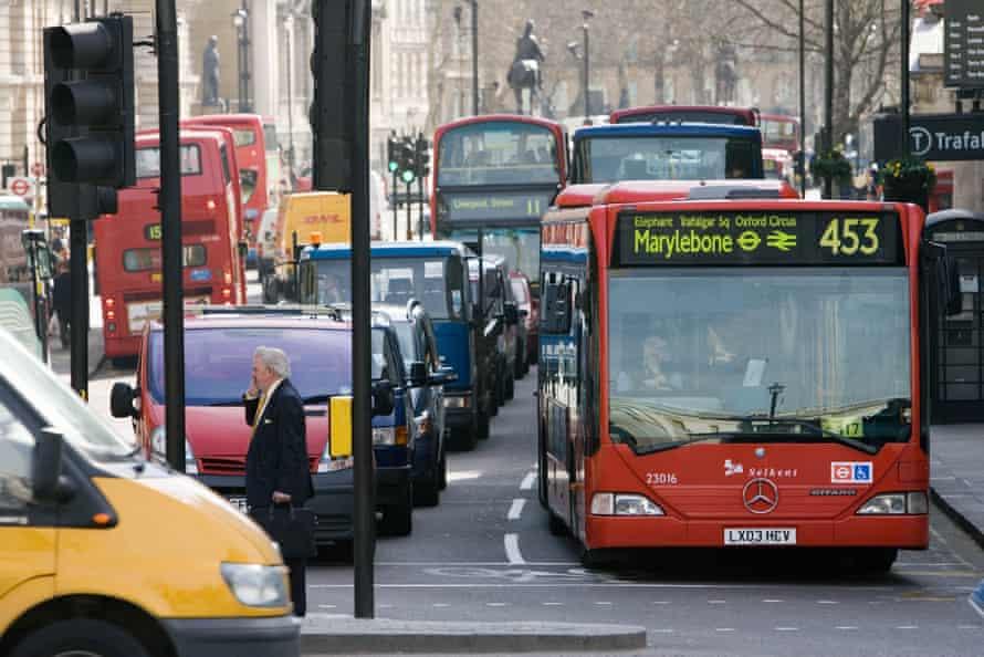 Heavy traffic at a standstill at traffic lights in Trafalgar Square, London.