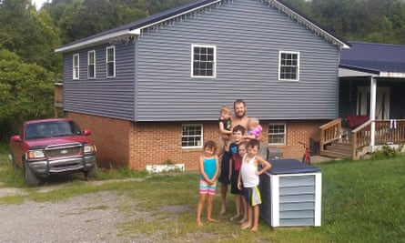 Brandon Dennison, 29, with his six children at home in Thurman in Gallia county, Ohio. Courtesy of the family