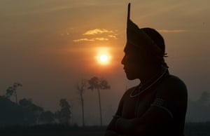 A Kayapo Indigenous man attends a protest at sunrise as they block highway BR-163 near Novo Progresso, Para state.
