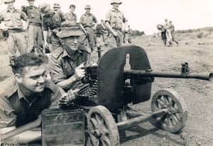 Harry Smith, shown behind the gun, fought in the battle of Long Tan in 1966