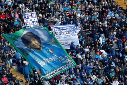Napoli fans display a banner for their former player Diego Maradona before a match at San Paolo stadium in 2017.
