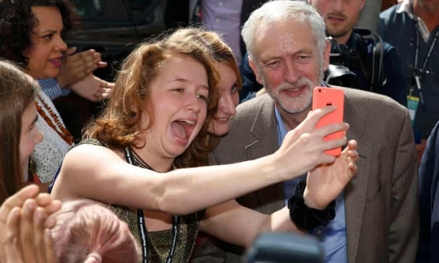 'Corbynmania': Corbyn poses for a selfie with a supporter as he arrives at the beginning of the Labour conference in Brighton.