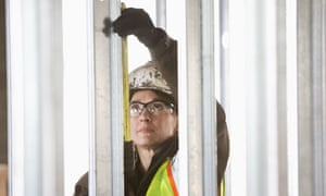 Woman working on building site