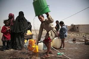 Sanaa, Yemen A boy rinses a bucket