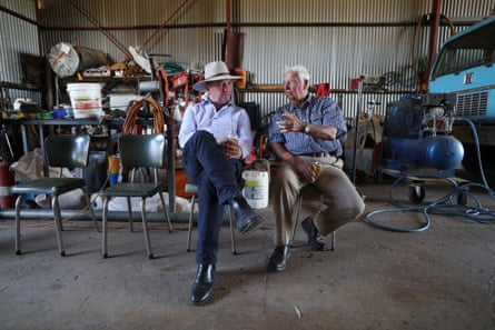 Barnaby Joyce has a chat with a farmer in a shed in Duri