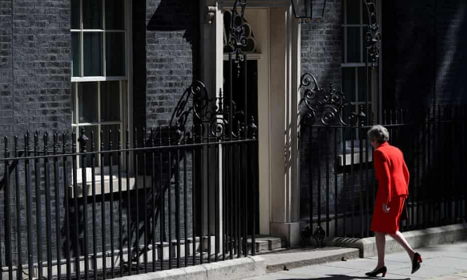 Theresa May returns to 10 Downing Street after her resignation speech.