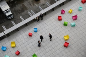 """Chairs for gallery-goers with 'museum legs' … Heilmann's' installation """"Sunset at the Whitney Museum in New York."""