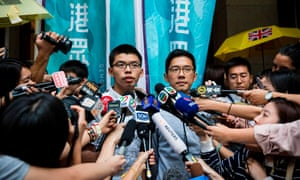 Pro-democracy activists and Demosisto members Joshua Wong (left) and Nathan Law speak to the media outside the court of final appeal after their bail applications were successful.