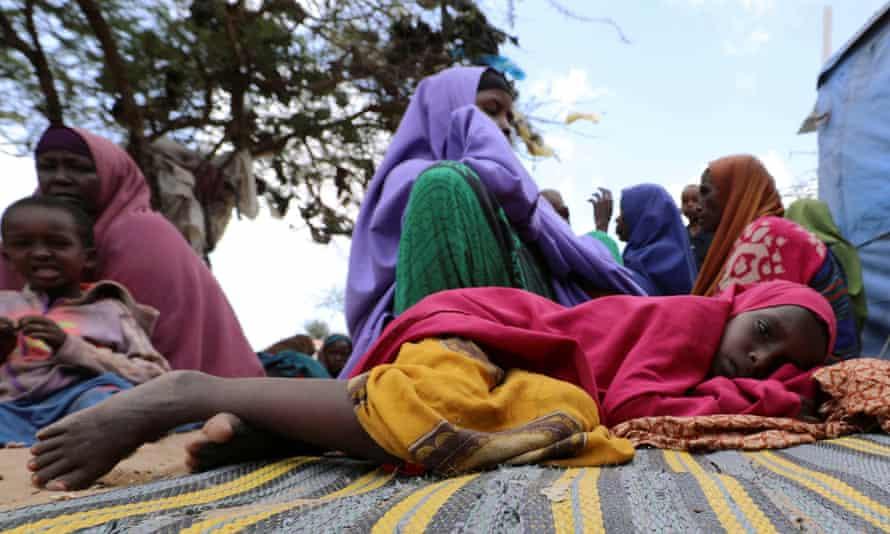 Somali girl rests at a camp near Mogadishu