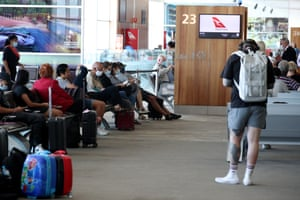 Passengers wait for a Qantas flight to Canberra at Adelaide airport in November.