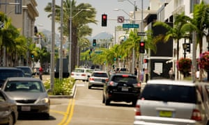 Cars drive down Rodeo Drive in Beverly Hills