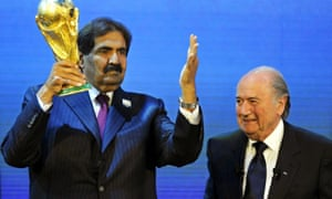 Sepp Blatter, right, and Sheikh Hamad bin Khalifa Al-Thani, Emir of Qatar, with the World Cup trophy after Qatar was announced as the host for 2022.