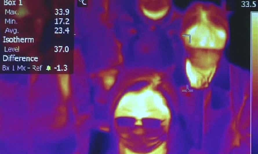 Scanning the body heat of passengers at Rome airport.